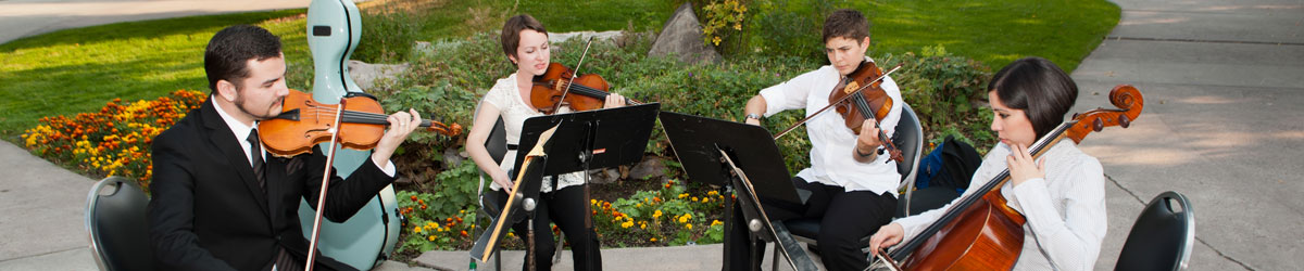 A student string ensemble performs for donors.