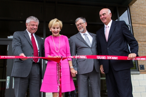 Dean Larry Gianchetta, Priscilla Gilkey, President Royce Engstrom and Harold Gilkey cut the ribbon